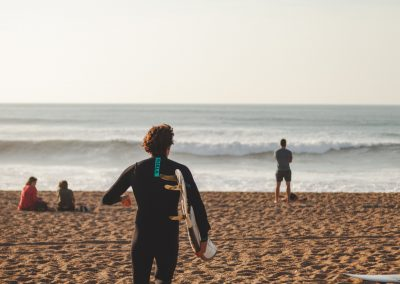 man-in-black-wetsuit-at-the-beach-3726673